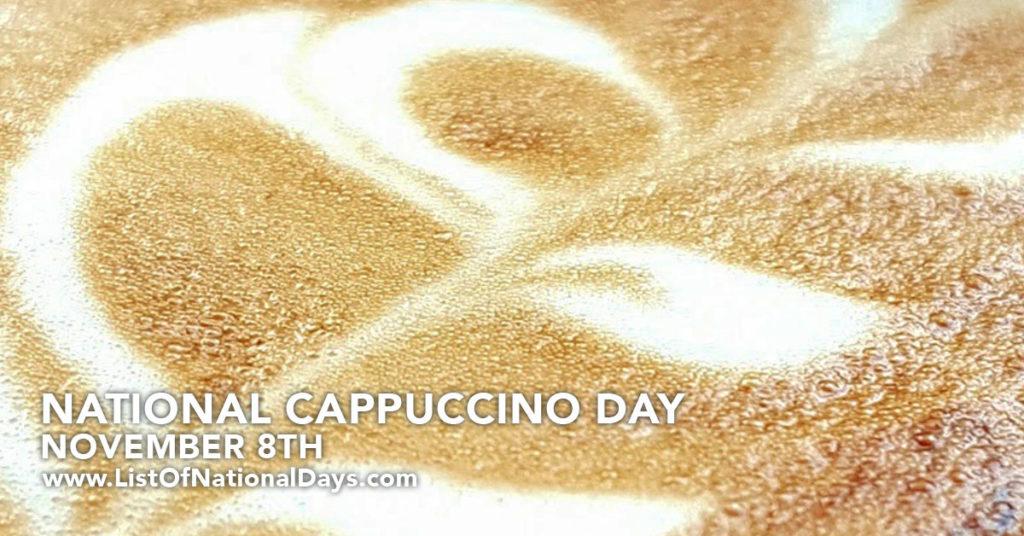A close up of a leaf foam art in a cup of cappuccino
