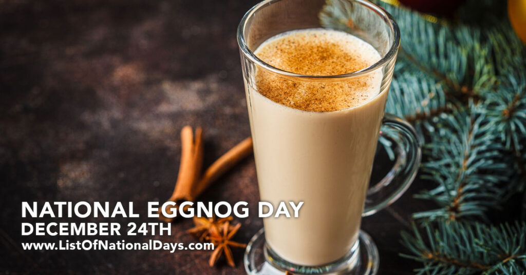 A tall glass of egg nog with cinnamon sprinkles.