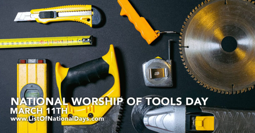 A variety of different tools on a dark gray table.